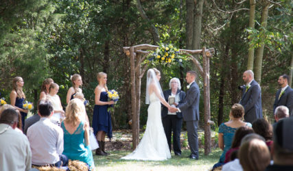 Handmade rustic tree branch wedding arch by South Ranch Creative. Photograph by Summer Kelley Photography.