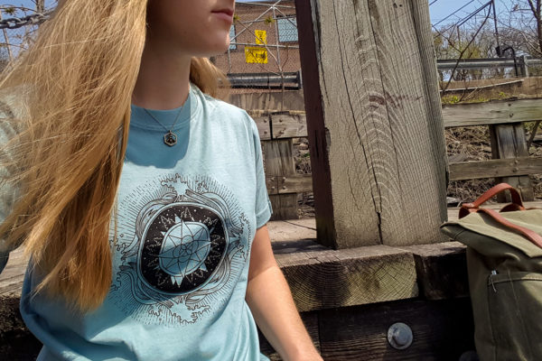 Find your Path Muted Blue Tshirt with Black Compass, Mountains, and Waves Design
