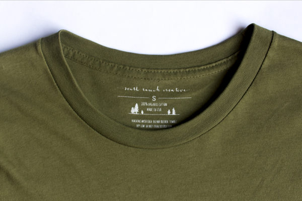 Explore tshirt label closeup. Made from 100% organic cotton