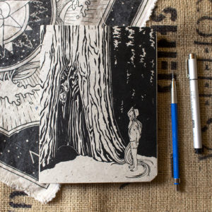 "Handmade 6x8"" sketchbook with black design on off white cover featuring girl looking up at a giant sequoia tree, her long hair turning into the roots of the tree"