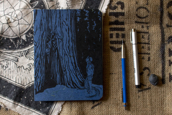 Blue option of girl and the sequoia sketchbook with black ink design